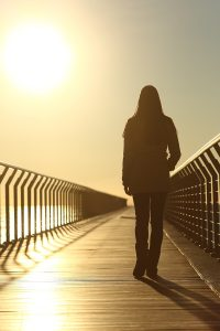 Sad Woman Silhouette Walking Alone At Sunset