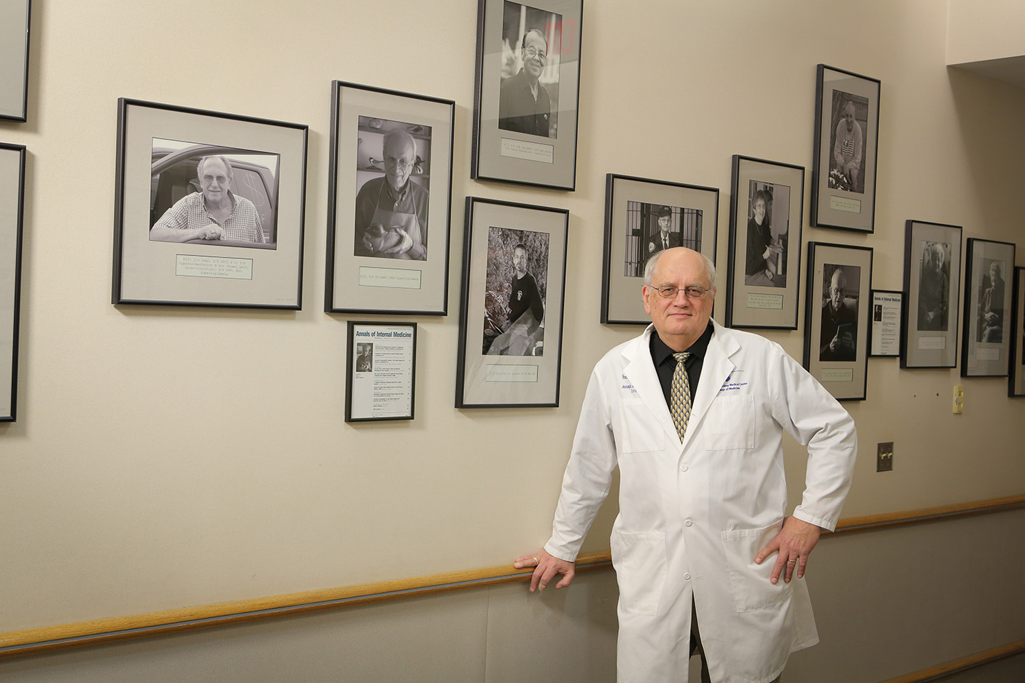 Dr. Joseph Gascho with portraits of patients