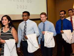 MS1 Trevor Jamison, center, at Baylor's 2018 White Coat Ceremony