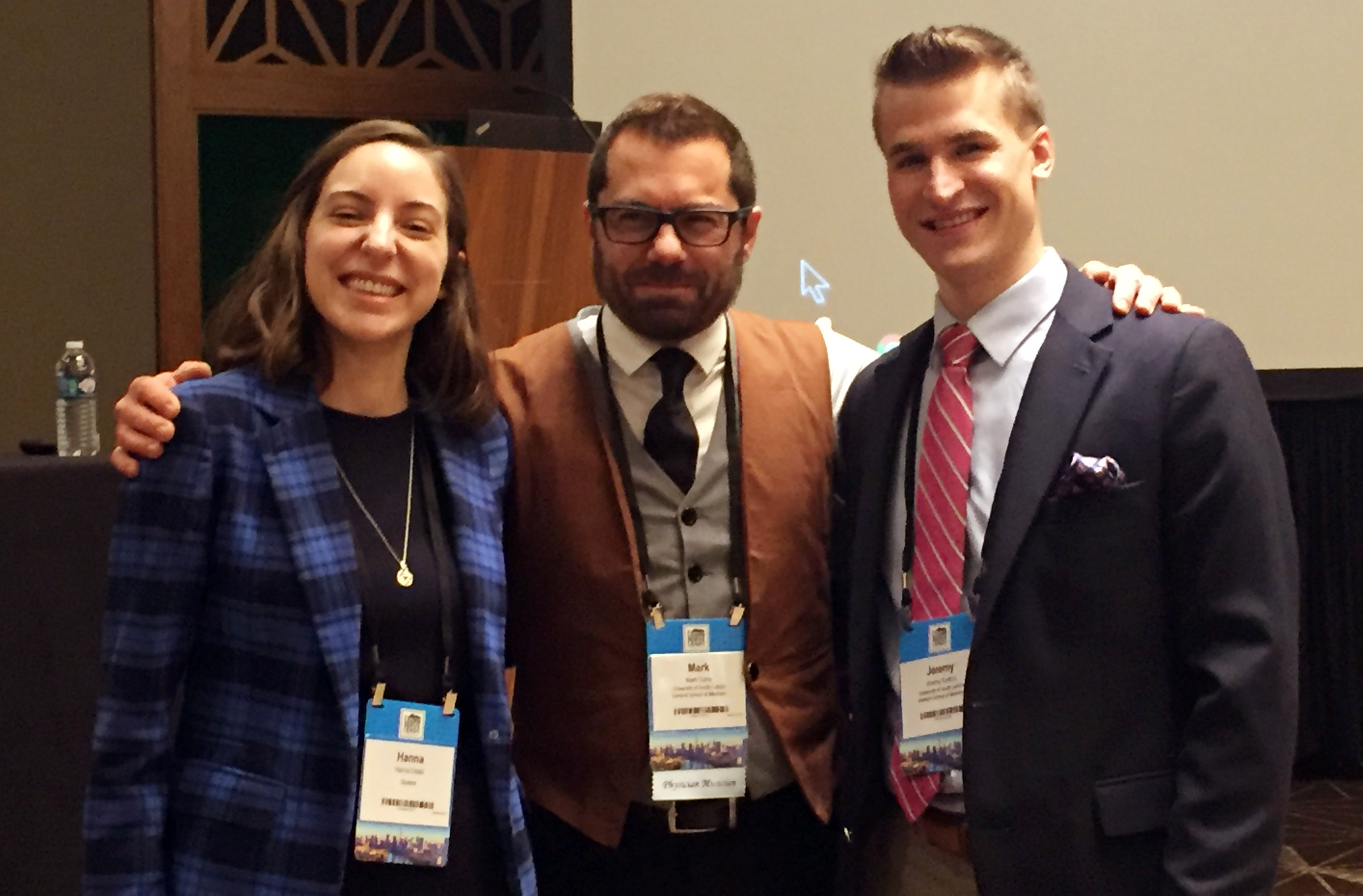 From left, fourth-year student Hanna Distel, Dr. Mark Garry, and third-year student Jeremy Kudrna. Hanna and Jeremy nominated Dr. Garry, who is a professor at University of South Dakota Sanford School of Medicine, for the Arnold P. Gold Humanism in Medicine Award. This photo was taken at a ceremony on Nov. 2, 2018, to honor Dr. Garry, who also gave a presentation to the AAMC Organization of Student Representatives during the luncheon.