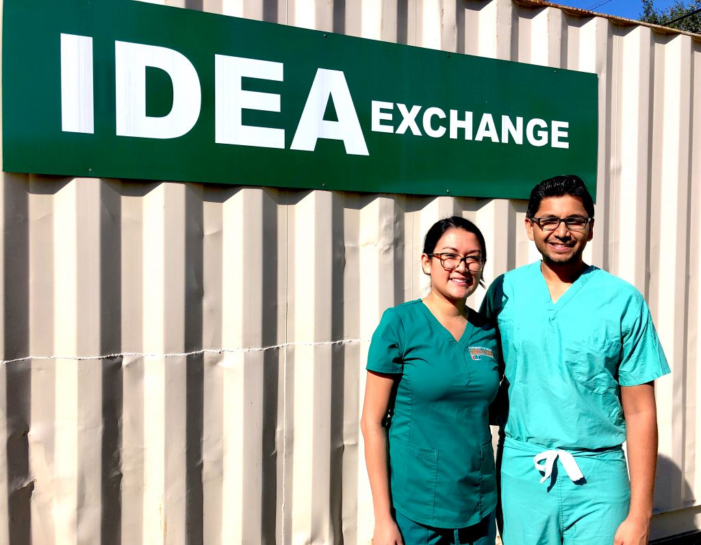 Gabriella Amaya (left), Atoofa Baig (not pictured), and Heidi Iskander (not pictured) are senior BSN students at University of Miami who serve as patient navigators for the Patient Navigation Program - the result of a Gold Student Summer Fellowship awarded to Hardik Patel (right), director of the Patient Navigation Program and a second-year MD/MPH student. (Credit: IDEA Wound Care Clinic)