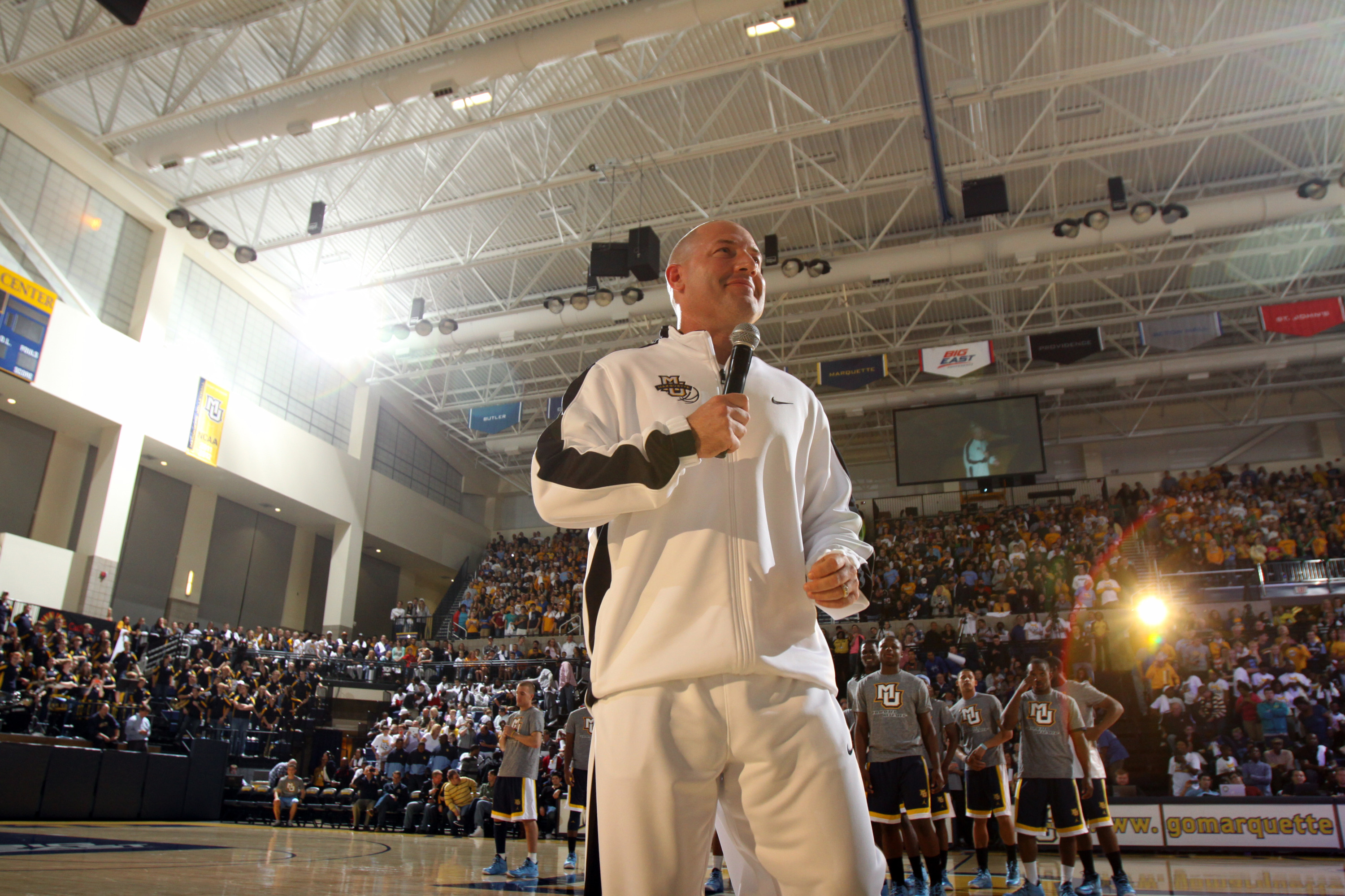 Men's basketball head coach Buzz Williams addresses the capacity crowd Friday night at the Al McGuire Center