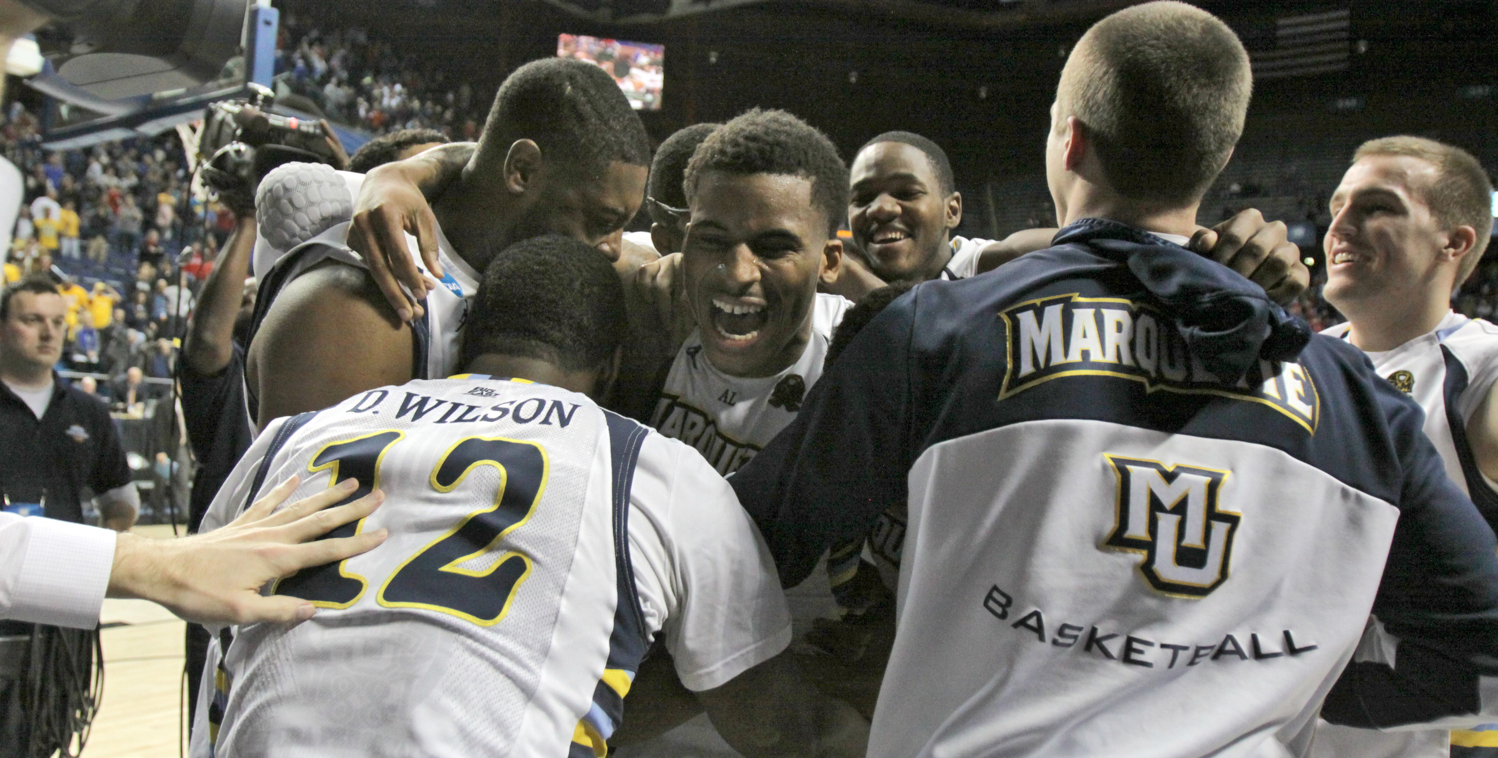 Vander Blue celebrates with teammates Thursday after Marquette's NCAA tournament win over Davidson College.