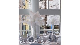 Image of a Ostrich Feather Centerpiece Trumpet Vase With Pearl Fillers