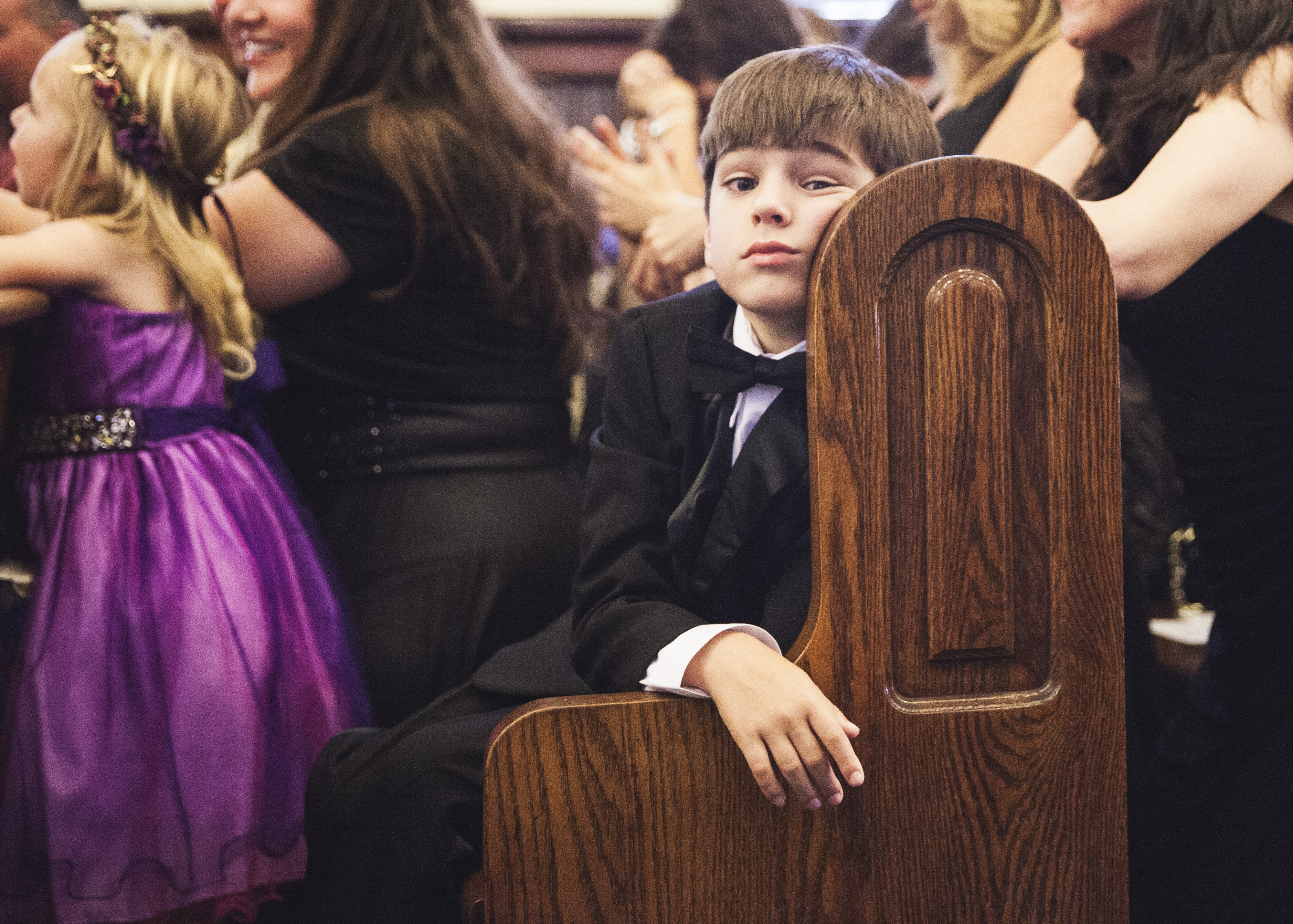 bored kid at wedding. Photos from the Harty. http://www.photosfromtheharty.com/