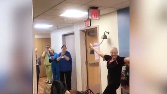 Woman rings bell for beating cancer during coronavirus pandemic