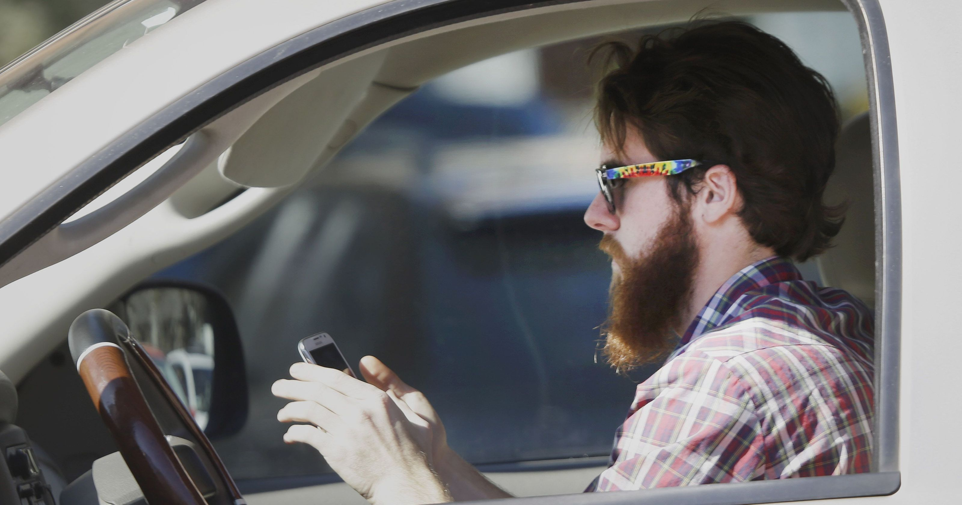 Risky phone use while driving is soaring and it's killing Americans, IIHS study finds