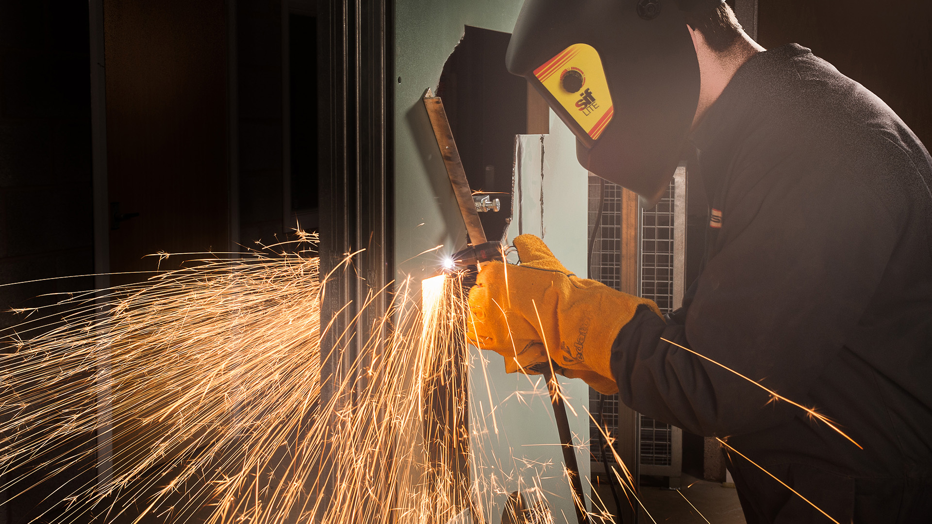 MMC Engineering, Milnthorpe, Cumbria; workshop showing apprentice engineer cutting metal components with oxy acetylene torch! Commercial shoot.