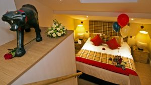 Room View of double bed & luxury welcome pack