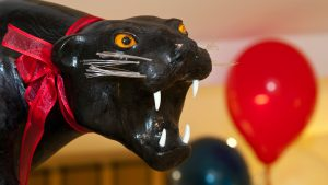 Hotel Room Detail: Panther with white fangs and red ribbon collar