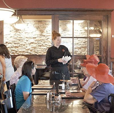 Pizzeria employee taking order at restaurant
