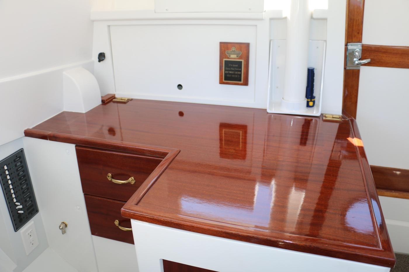 1980 Bill Garden Pocket Cruiser 20, Varnished mahogany desk top