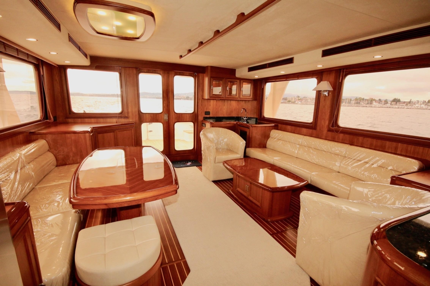 2020 Fleming 65 Pilothouse In Stock, Salon Aft view