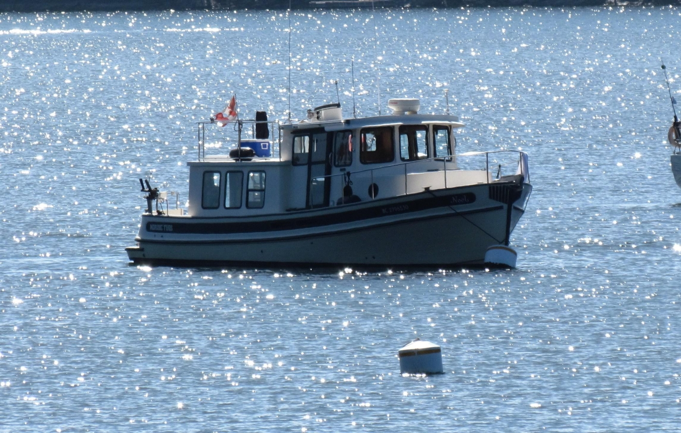 1999 Nordic Tugs 32, At Ease on a Mooring