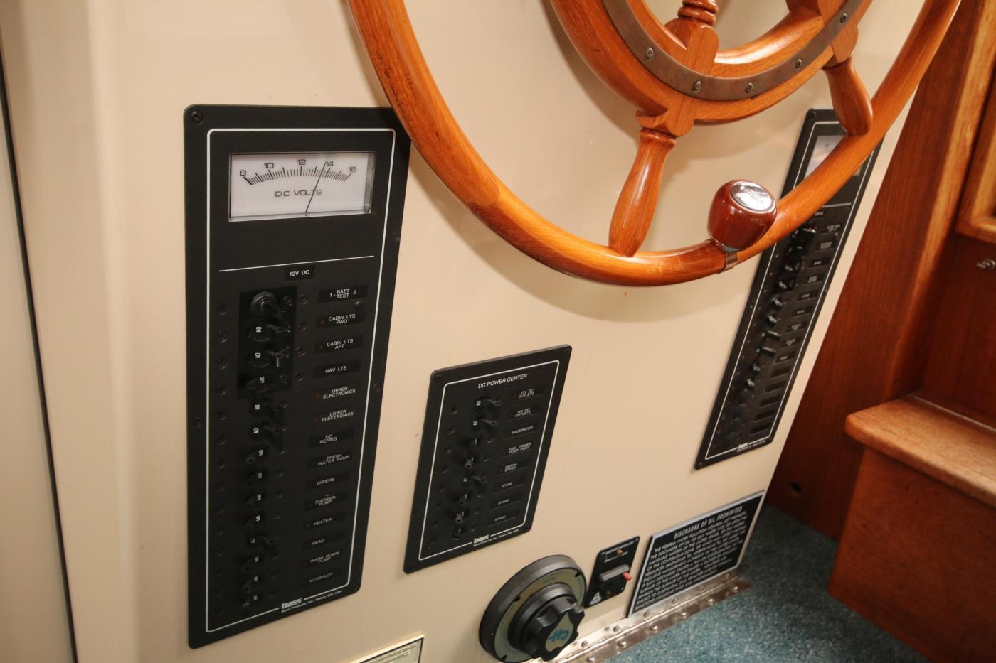 1999 Nordic Tugs 32, Electrical Panels below Helm