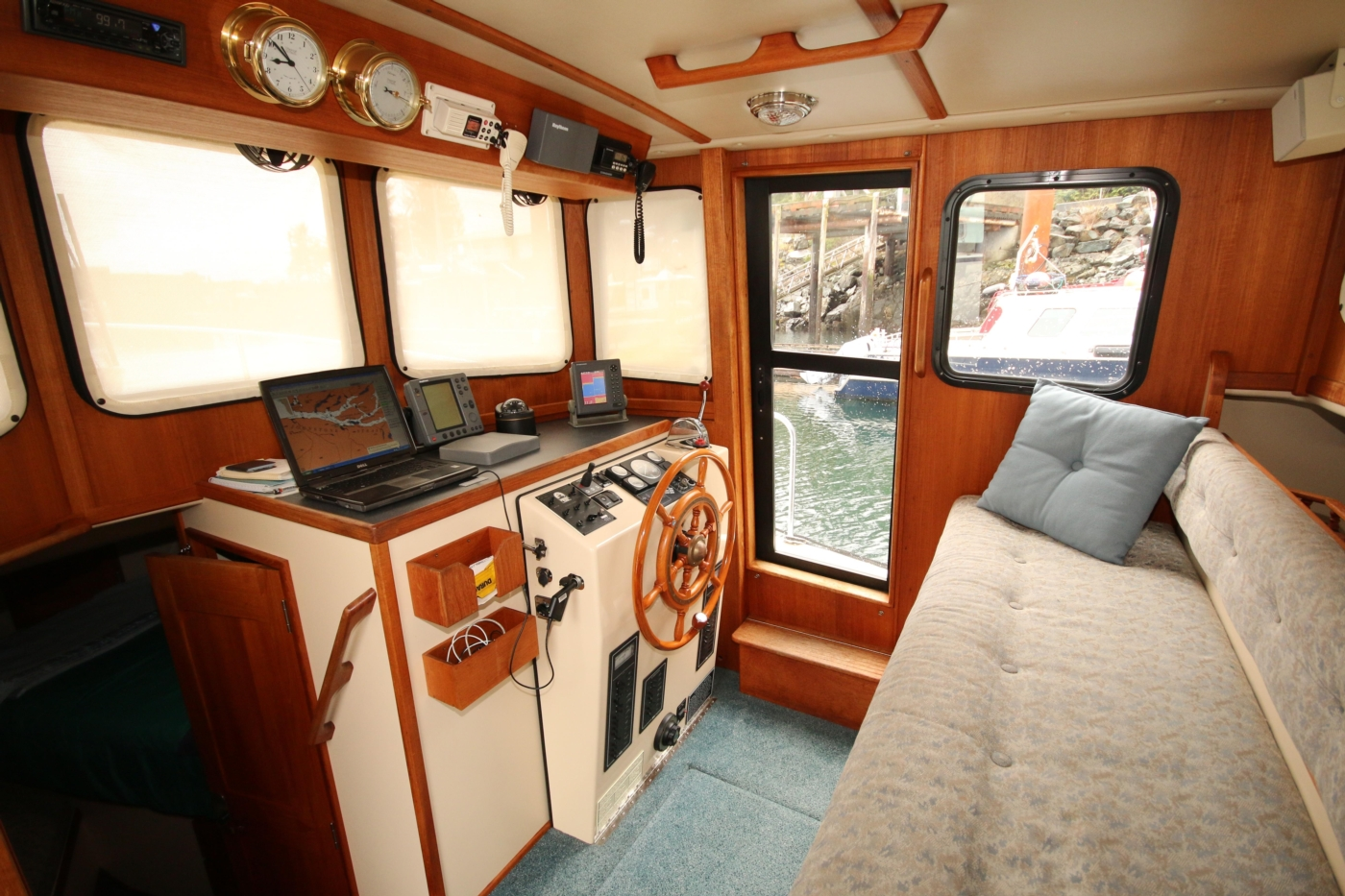 1999 Nordic Tugs 32, Pilothouse Settee and Helm Area