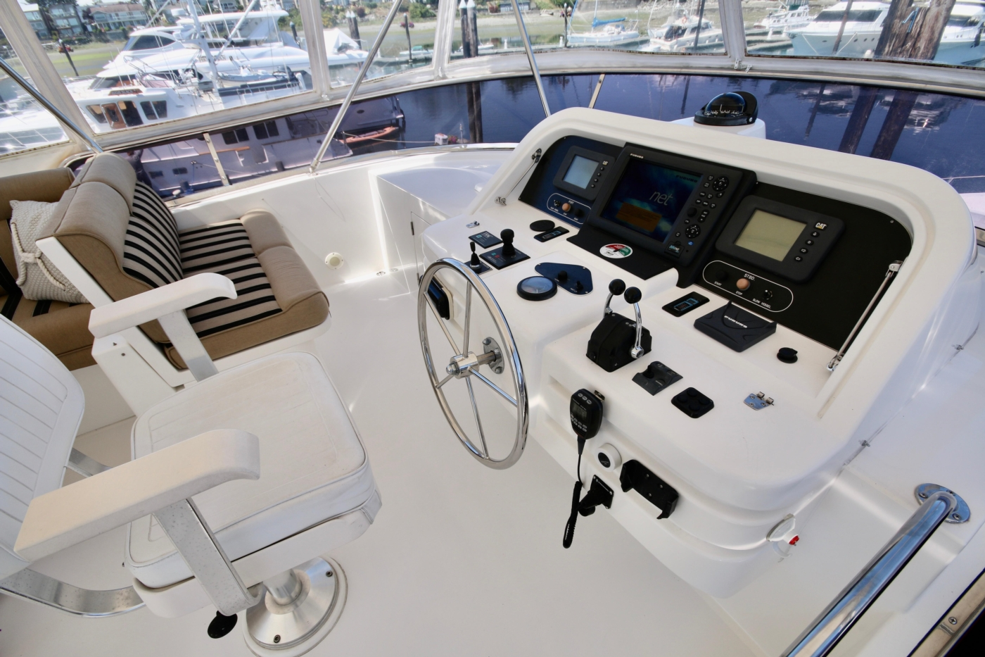 2002 Monte Fino 68, Flybridge Helm with Seating for 3