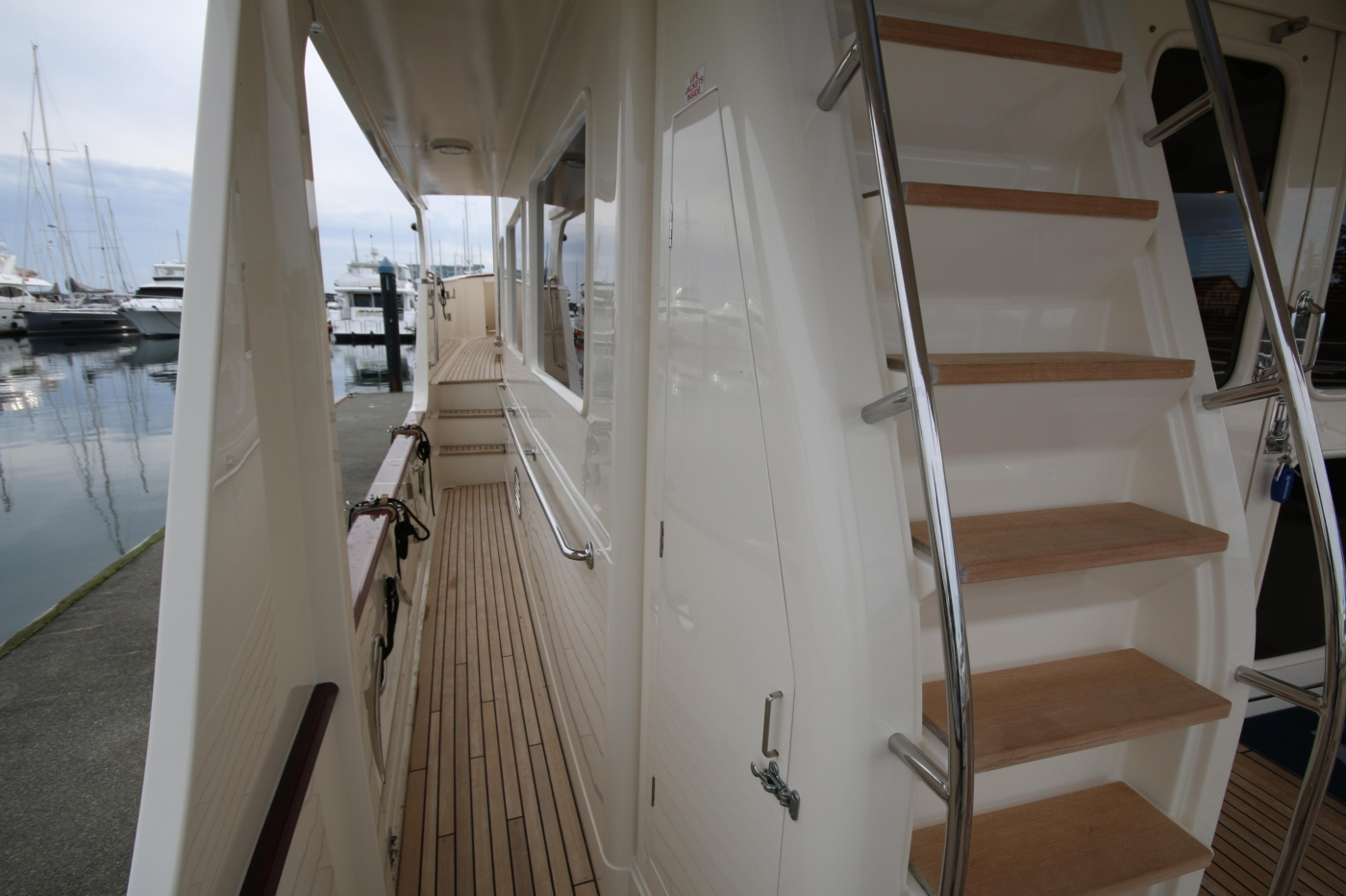 2015 Fleming 58 Pilothouse, Stairs with wet hanging locker