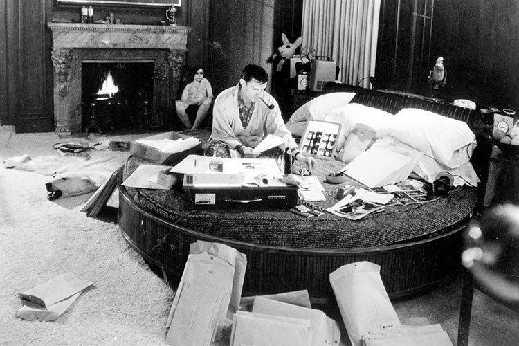 Hefner Working In His Bedroom/office At The Chicago Mansion. (Photo  Provided By Playboy Enterprises)