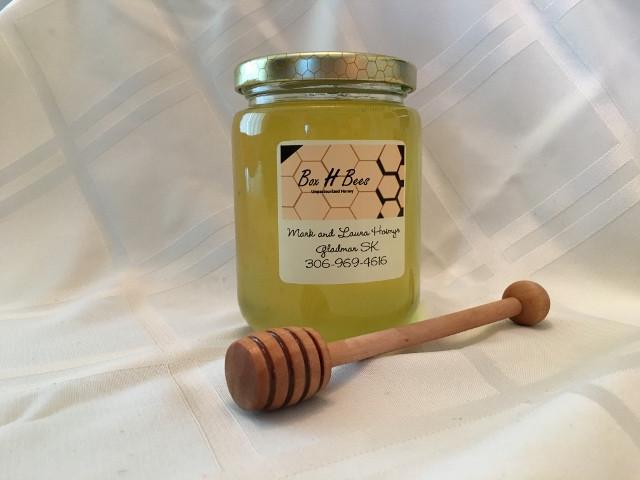 Small glass jar liquid honey