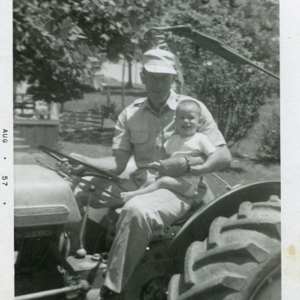 4) R.O. with one-year-old Roger (Roger Oliver Slusher, Jr., with Roger Oliver Slusher, III) on the original Ferguson tractor