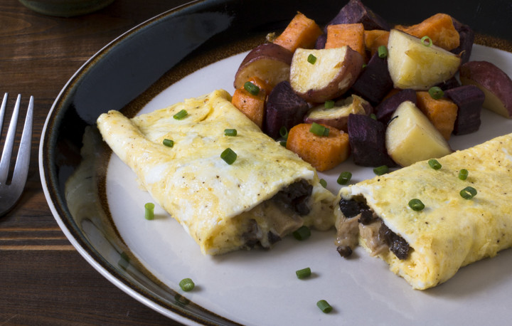 Chicken Neck Meat, Morel Mushrooms, and White Cheddar Cheese Omelet, with Duck Fat Roasted Mixed Potatoes