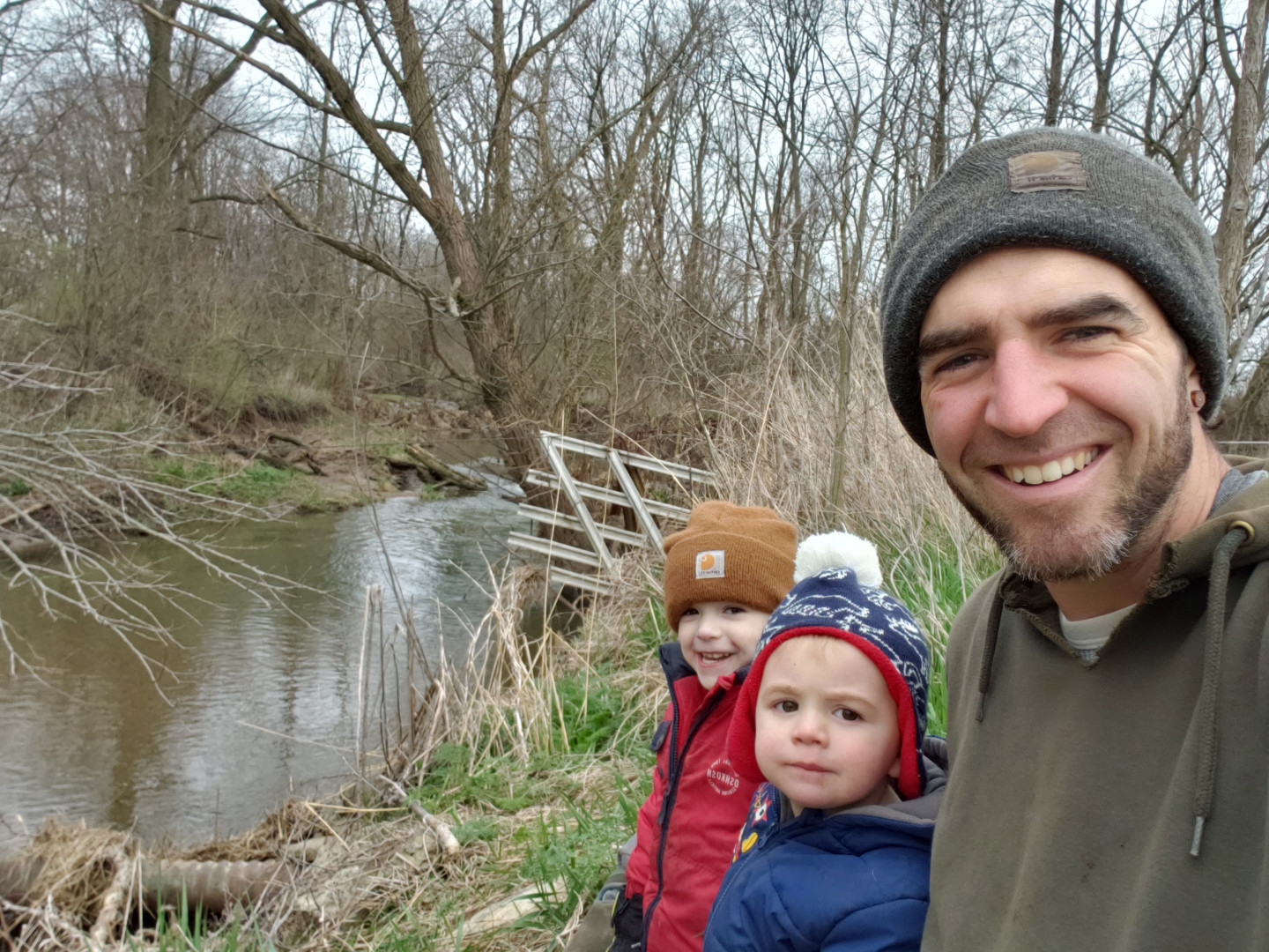 ben, owen and lincoln listening to the creek