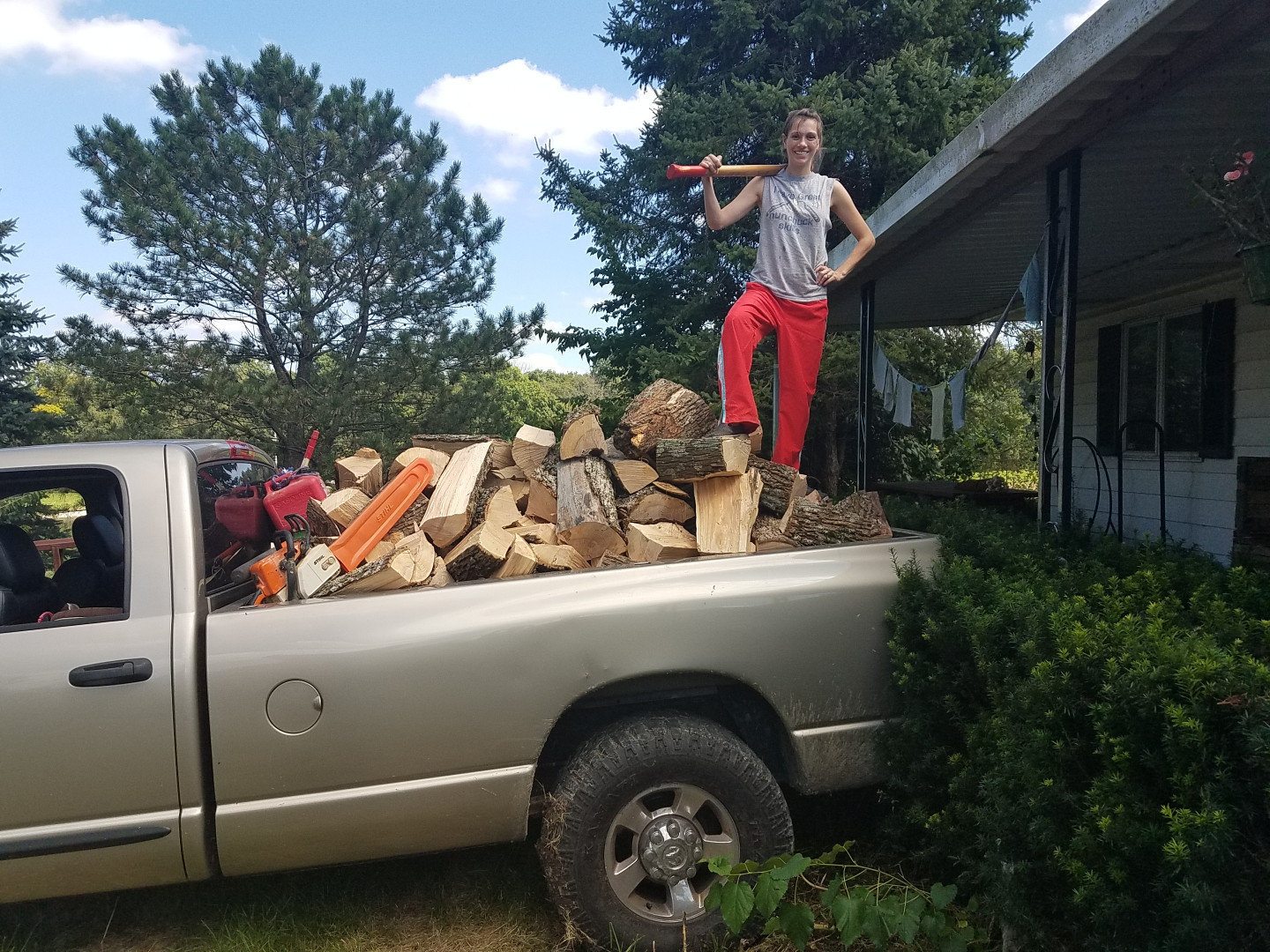 Ermma with a victorious load of firewood
