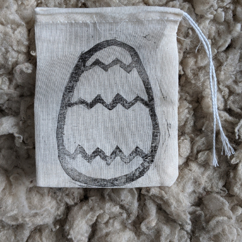 Egg Stamped Pouch