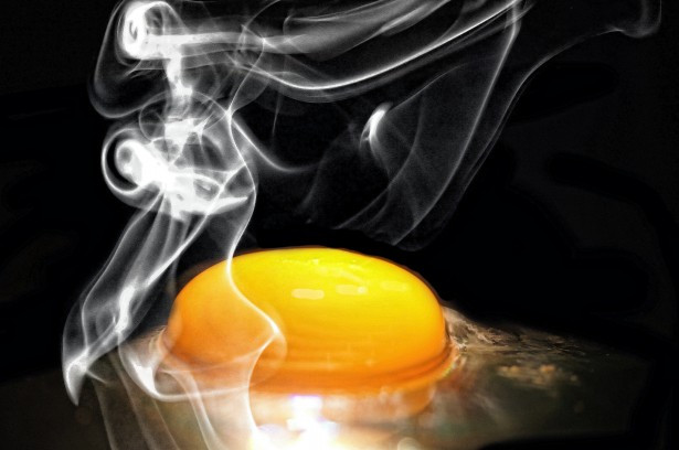 What happens to an egg when it's cooking?