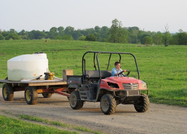Driving-out-the-lane-with-the-water-wagon.jpg