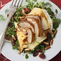 Grilled goat's cheese and pear salad with cranberries & pine nuts