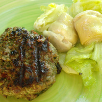 Beef burgers with cheese, tomato and mixed greens