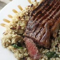 Steak on a blue cheese, spinach & pecan risotto