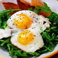 Breakfast Salad Eggs over easy over Arugula with Shaved Parmesan