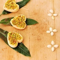 Orange infused mava barfi jewelled with pistachios