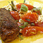 Steaks with pesto, tomatoes and feta cheese