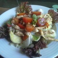 chicken, cherry tomato and iceberg lettuce salad
