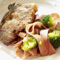 Veal cutlets with spiked pasta