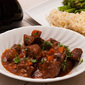 Braised beef in rich tomato and anchovy sauce