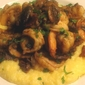 Sauteed shrimp with Chorizo, Mushrooms, Green Onions & Smoked Apple Wood Bacon on a bed of Cheddar Grits