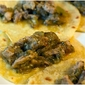 Pork Tacos cooked in a spicy green chili sauce