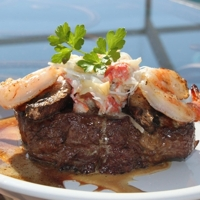 Filet Mignon Topped With Shrimp, Crab with a Garlicy Wine Sauce