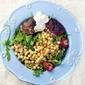 Renoir-inspired couscous with strawberries and loukaniko