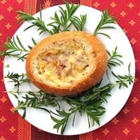 Green garlic bacon quiche in a bread bowl