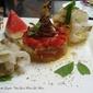 Ratatouille moderna di mare con origano fresco siciliano menta ed anguria con ruote di calamaro del litorale ripostese ionico