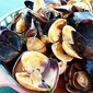 Clams and mussels in tomato broth