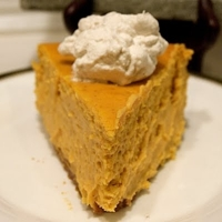 Pumpkin Cheesecake with Fresh Spiced Whipped Cream