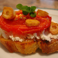 Slow Roasted Tomatoes on Bruschetta with sautéed Garlic & Goat Cheese