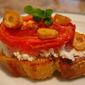 Slow Roasted Tomatoes on Bruschetta with sautéed Garlic & Goat Cheese